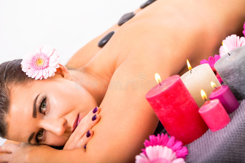 Young attractive woman hot stone massage wellness stock photography