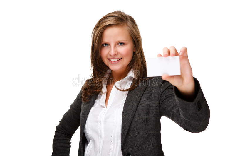 Businesswoman holding blank card. Young attractive woman isolated on white background royalty free stock image