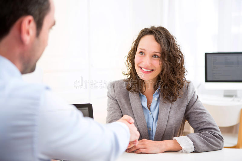 Young attractive woman during job interview stock photos
