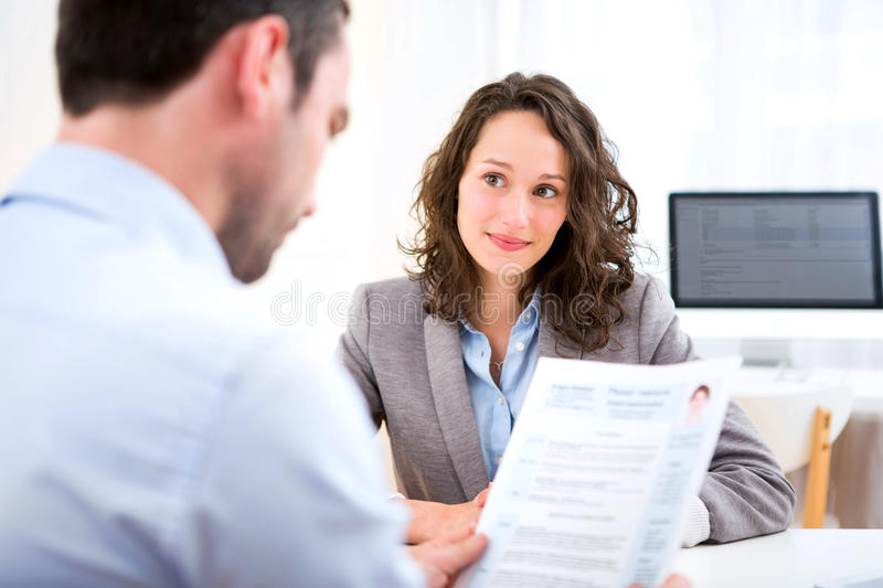 Young attractive woman during job interview stock photo