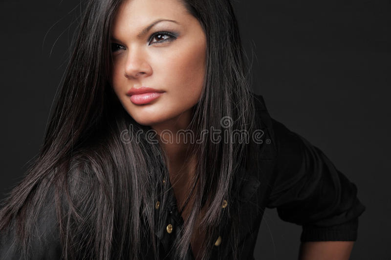 Young attractive woman with long black hair. royalty free stock photography