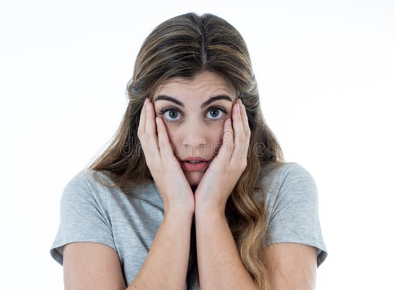 Young attractive woman looking scared, frightened and shocked. Human expressions and emotions stock photography