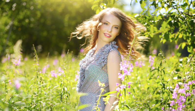 Young attractive woman outdoors stock images