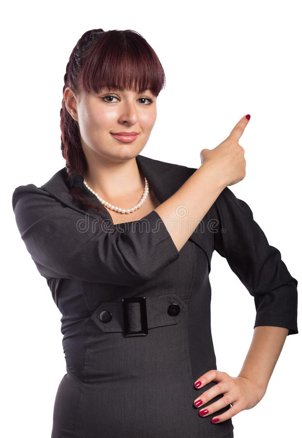 Young attractive woman points the finger at something stock image