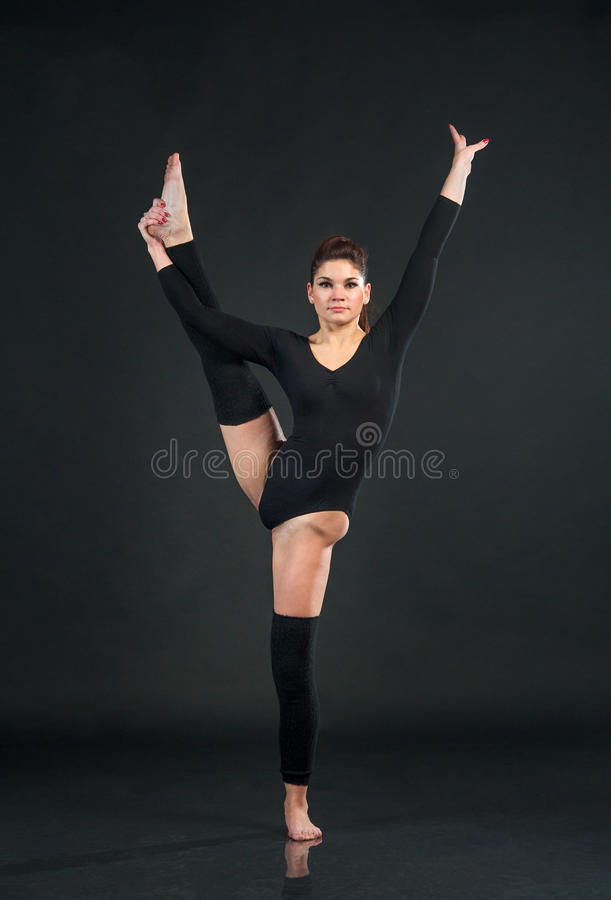 Young attractive woman practicing yoga, stretching in One legged stock photos
