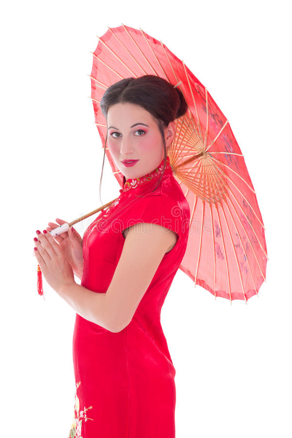 Young attractive woman in red japanese dress with umbrella isolated on white. Background royalty free stock photography