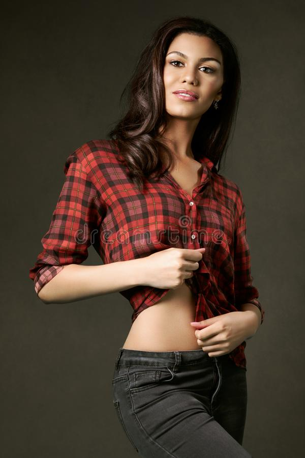 Young, attractive, woman in a red plaid shirt. royalty free stock photography