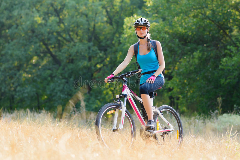 Young Attractive Woman Resting with Bike in the Beautiful Forest stock image