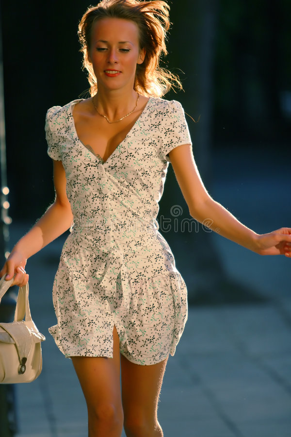Young attractive woman running royalty free stock photography