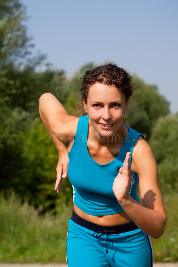 Young Attractive Woman Starting To Run Ourdoors Royalty Free Stock Images