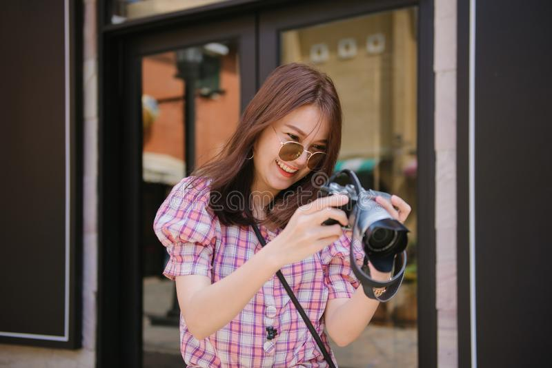 Young attractive woman checking photos on retro equipment. royalty free stock photo