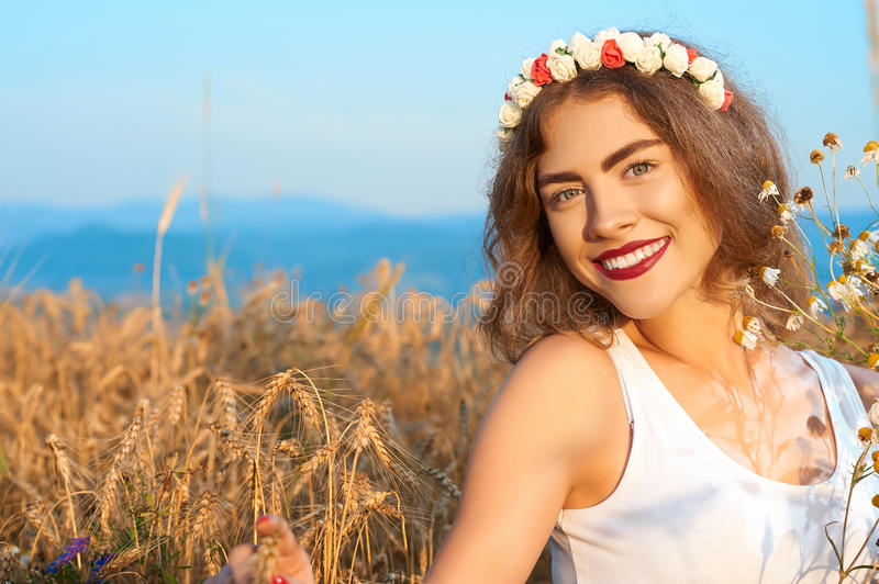 A young, attractive woman in swimsuit, posing in a field of flow royalty free stock images