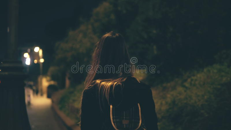 Young attractive woman walking late at night alone in Rome, Italy. Girl goes through the city centre near the Colosseum. stock images