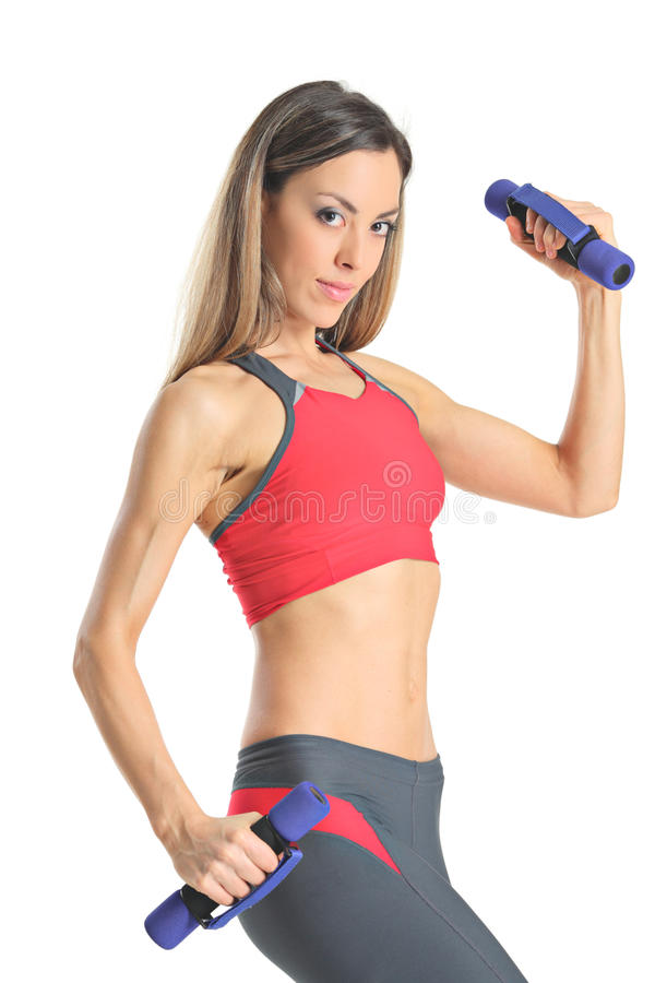 Young attractive woman with weights stock images