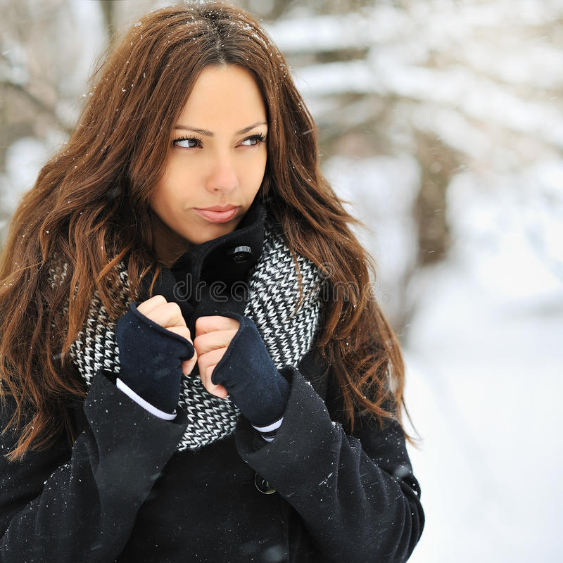 Young attractive woman in winter looking at copyspace - outdoor royalty free stock photography
