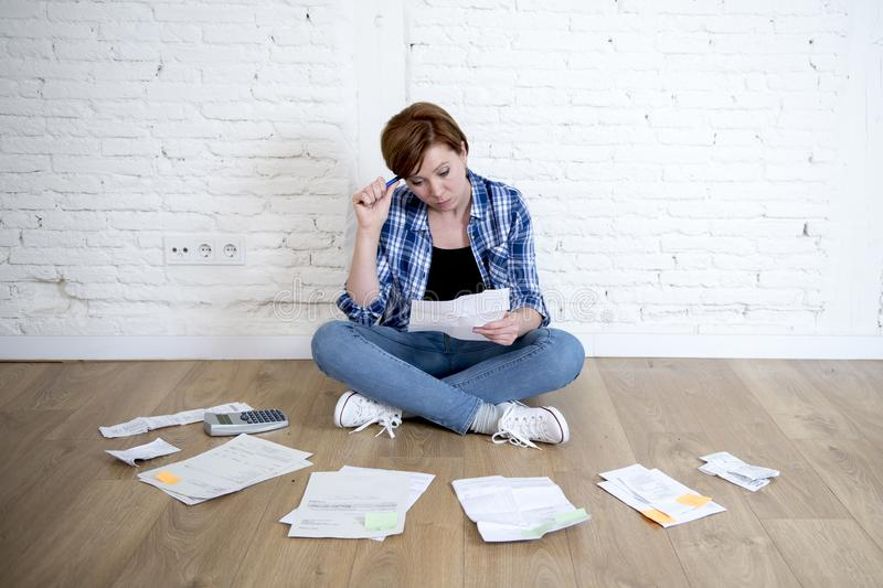 Download Woman At Living Room Floor With Calculator And Bank And Bills  Paperwork And Documents Doing