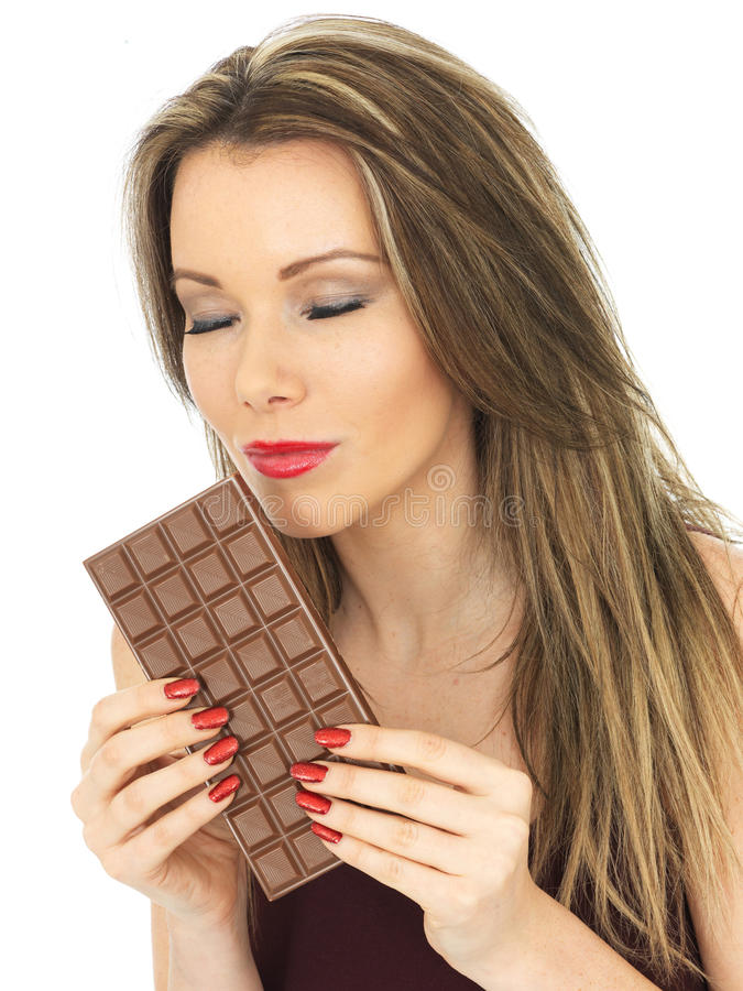 Young Attractive Young Woman Holding a Milk Chocolate Bar royalty free stock photography