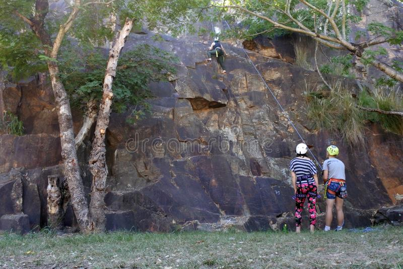 Young Australian people abseiling from a cliff in Brisbane Australia stock photo