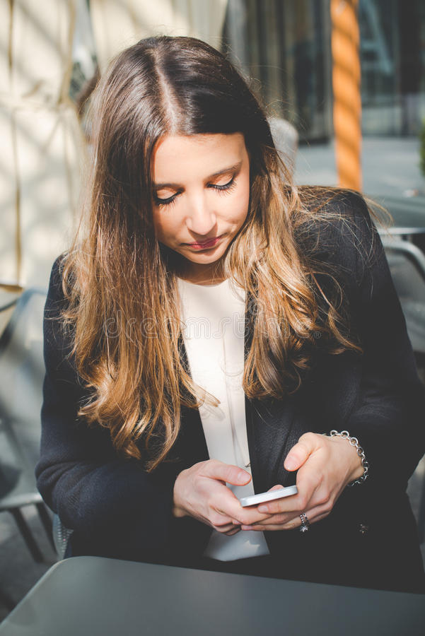 Young authentic business woman talking to mobile royalty free stock photo