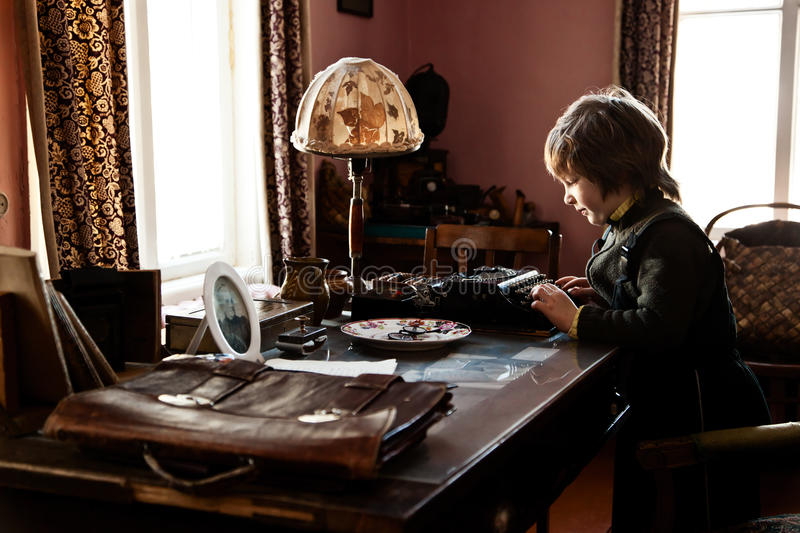 Young author. In a grand-dads room royalty free stock photo