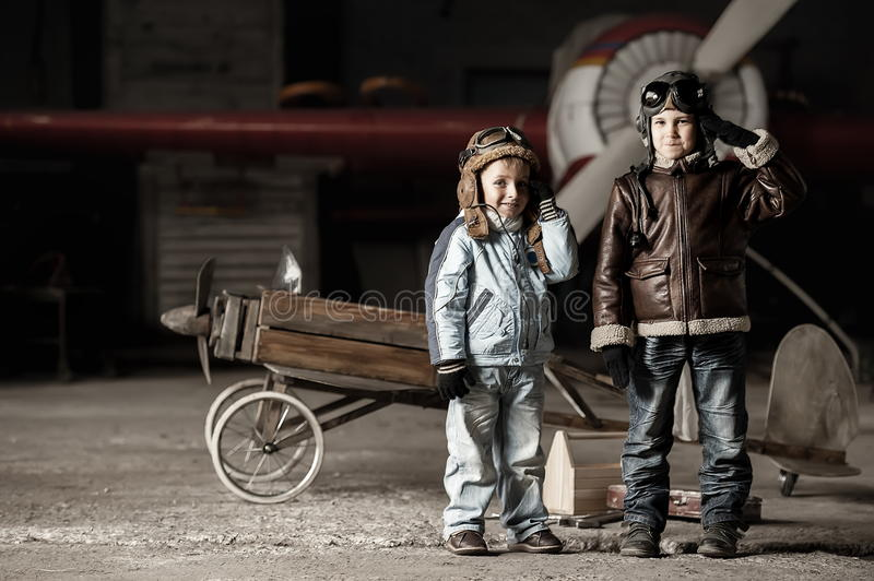 Young aviators. In homemade aircraft in a large hangar stock images