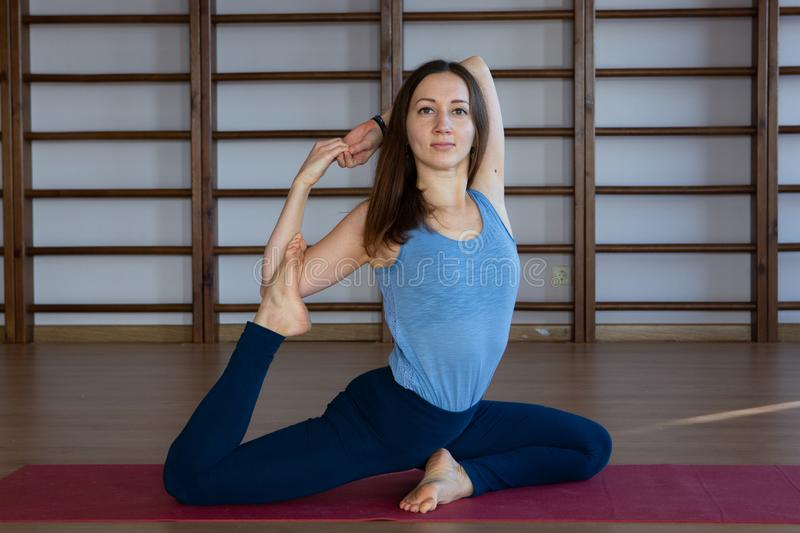 Young awesome happy woman developing flexibility. full length photo.yoga practise. Calmness and relax, female happiness concept royalty free stock photos