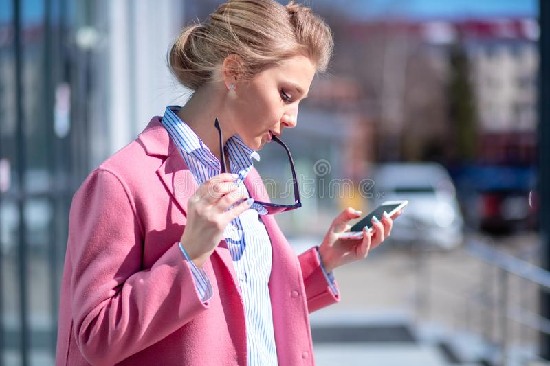 Young awesome woman dialing the number stock photography