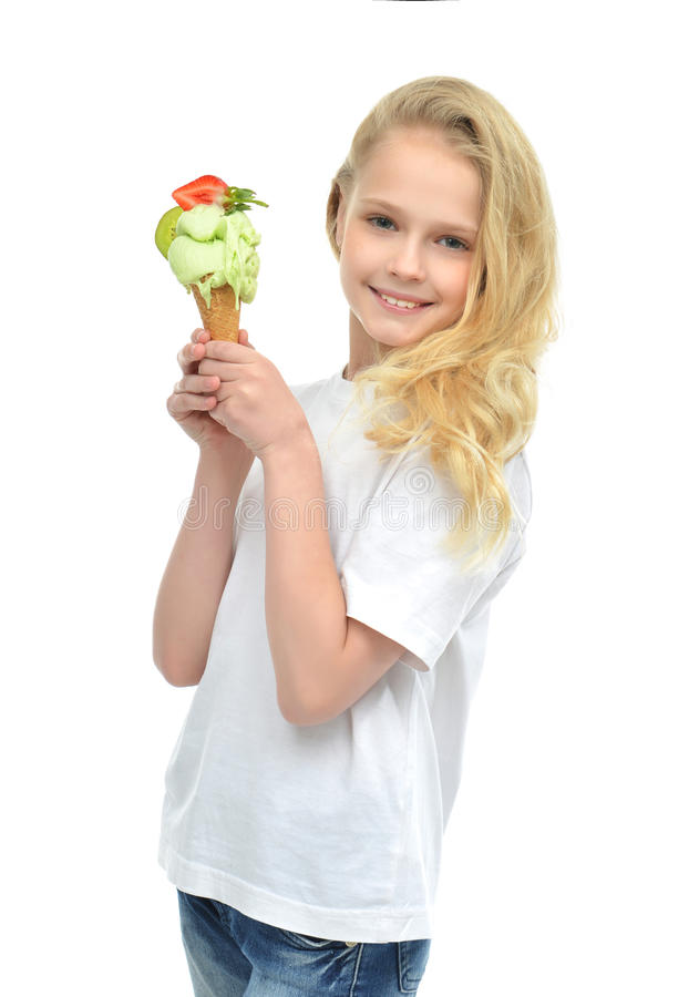Young baby girl ready for eating green pistachio ice cream in wa royalty free stock images