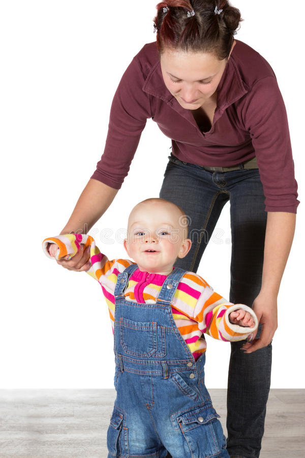 Young baby learning to walk royalty free stock image
