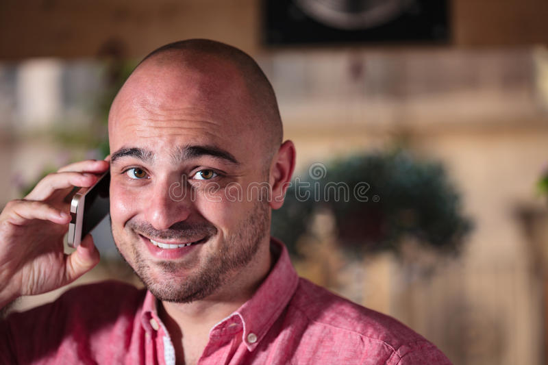 Young Bald Man on the Phone royalty free stock photography