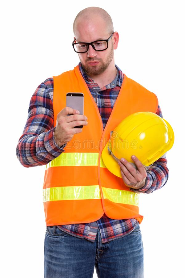 Young bald muscular man construction worker stock photography