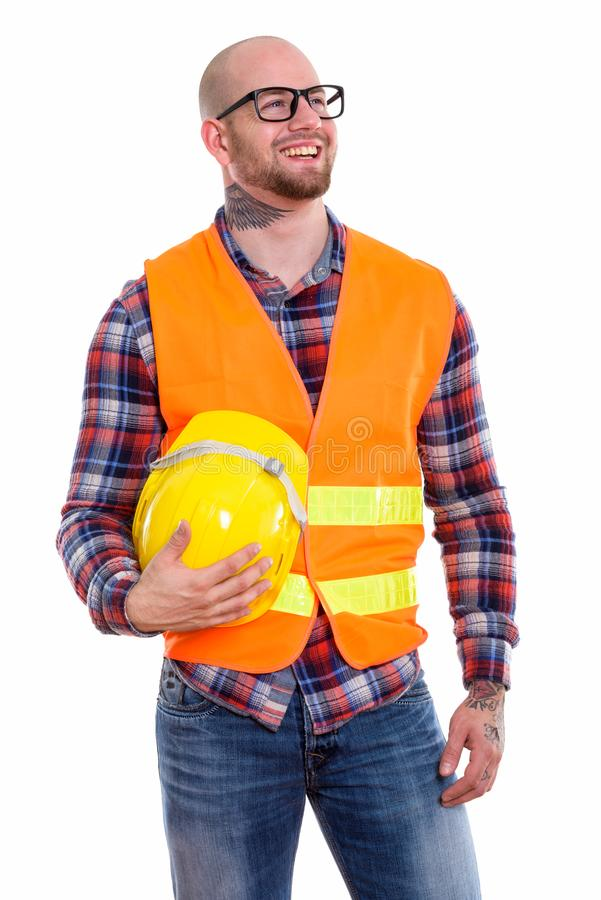 Young bald muscular man construction worker royalty free stock photos
