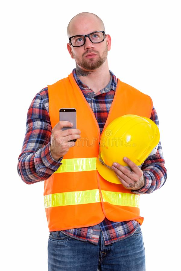 Young bald muscular man construction worker stock images