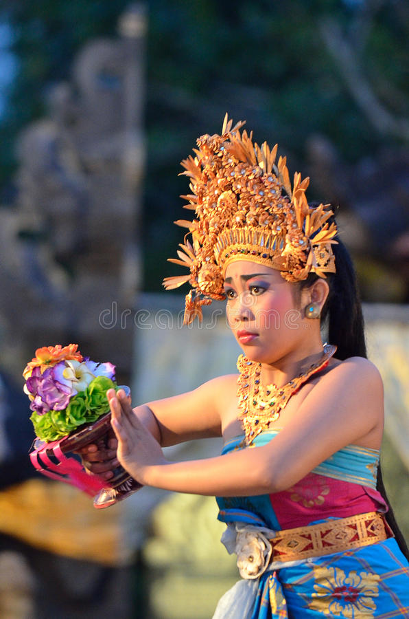 Young Balinese female dancer performing traditional dance royalty free stock photo