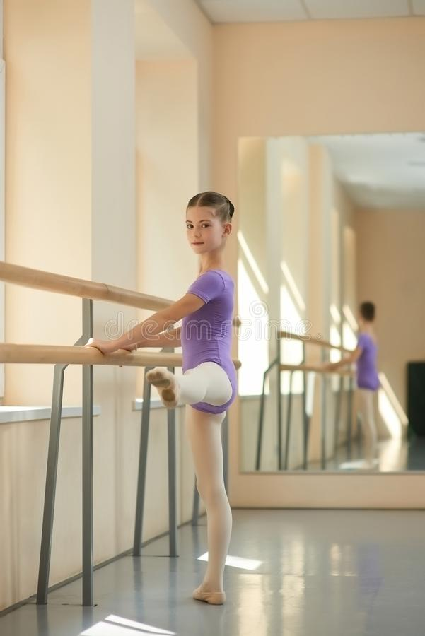 Young ballerina on barre in studio. royalty free stock photo