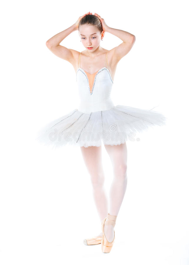 Young ballerina. Beautiful young ballerina on a white background royalty free stock image