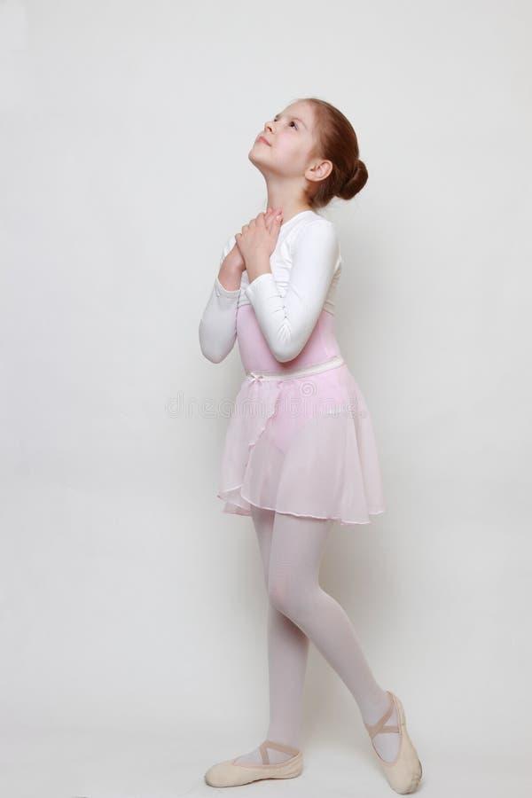 Young ballerina. Caucasian little ballerina in studio posing on camera stock photography