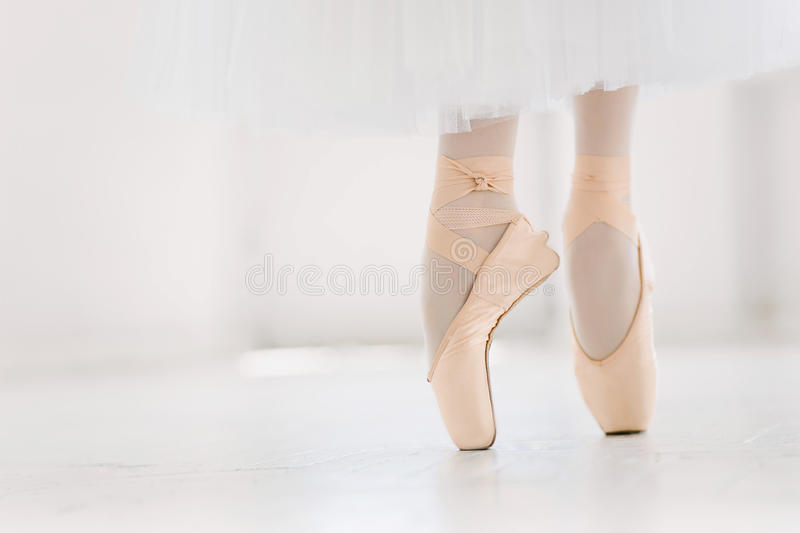 Young ballerina, closeup on legs and shoes, standing in pointe position. stock photography