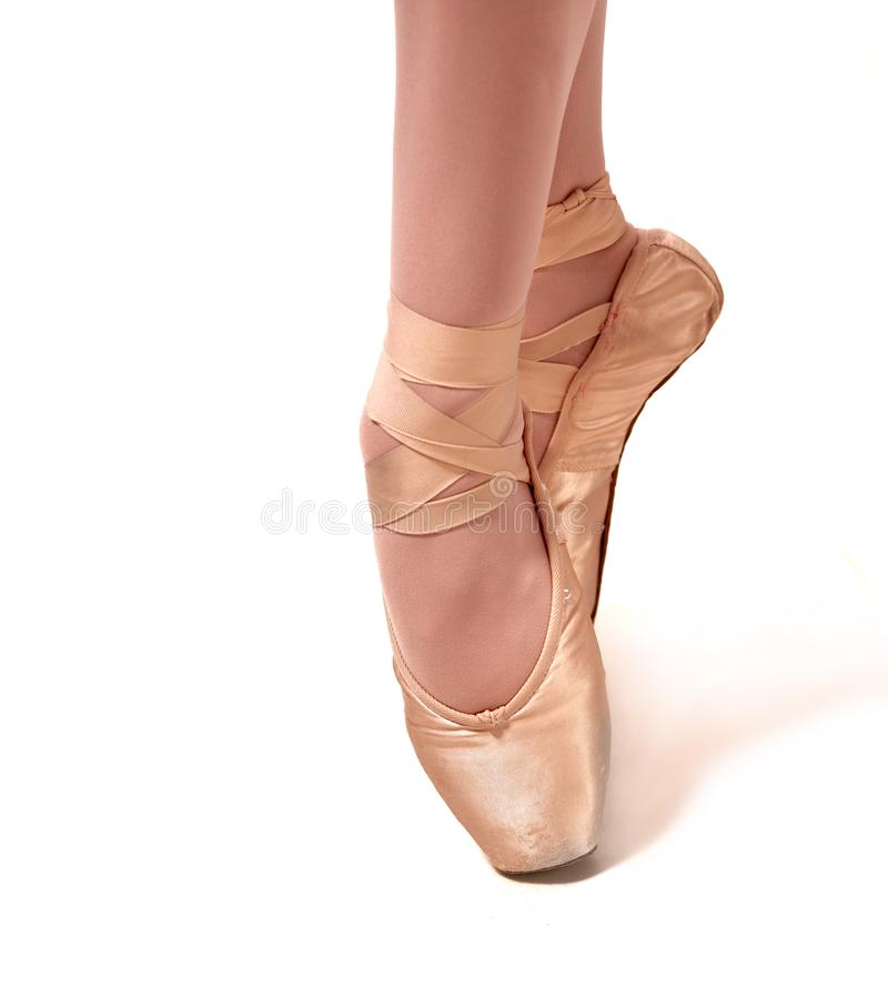 Young ballerina dancing, standing in pointe. stock photo