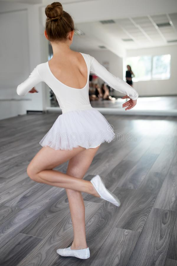 Young ballerina in tutu practicing dance moves. Young girl in ballet dress in dance school. Young ballerina in tutu practicing dance moves. Young girl in ballet royalty free stock images