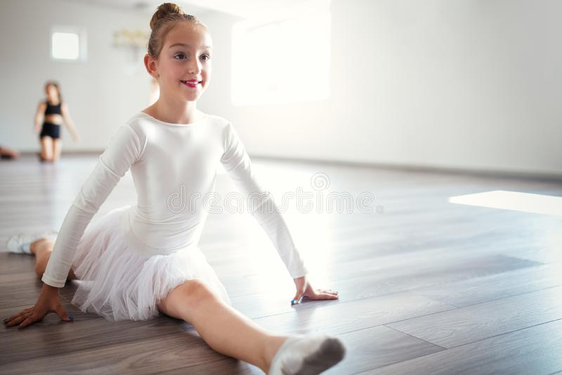 Young ballerina in tutu practicing dance moves. Young girl in ballet dress in dance school. Young ballerina in tutu practicing dance moves. Young girl in ballet stock photos