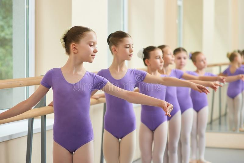 Young ballerinas in choreography class of ballet school. stock photos
