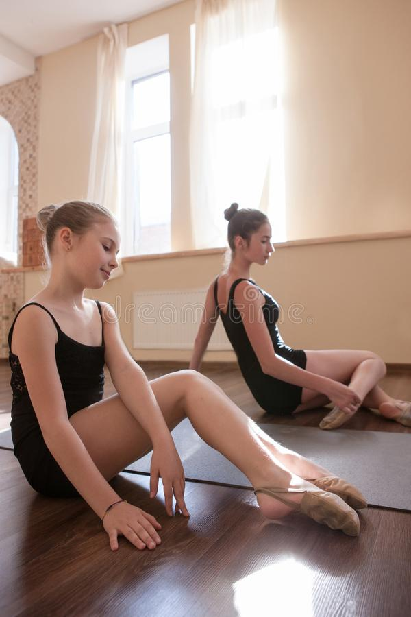 Young ballerinas exercises. Teenage sport royalty free stock photos