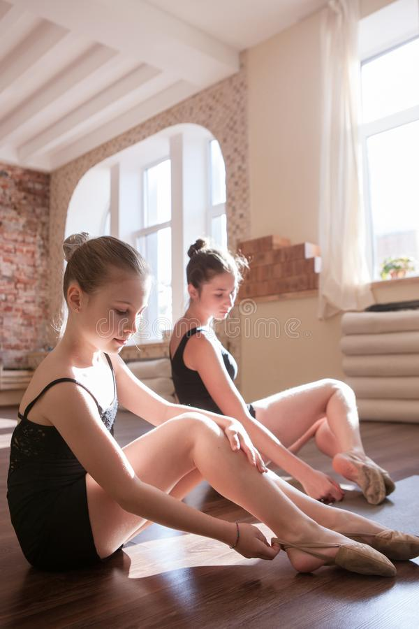 Young ballerinas. Pensive ladies in class royalty free stock images