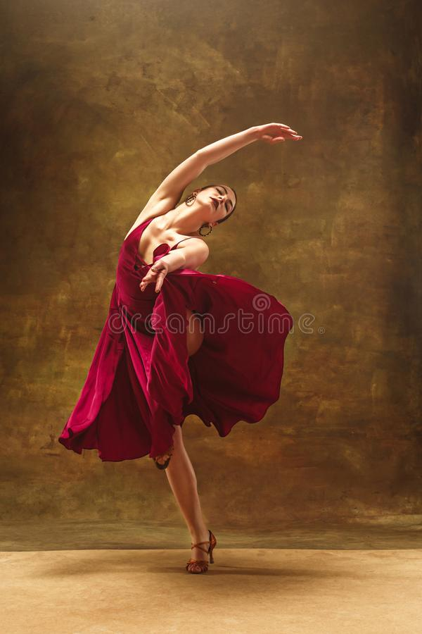 Young ballet dancer - Harmonious pretty woman with tutu posing in studio - royalty free stock photography