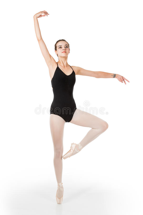 Young ballet dancer in passe en pointe stock image