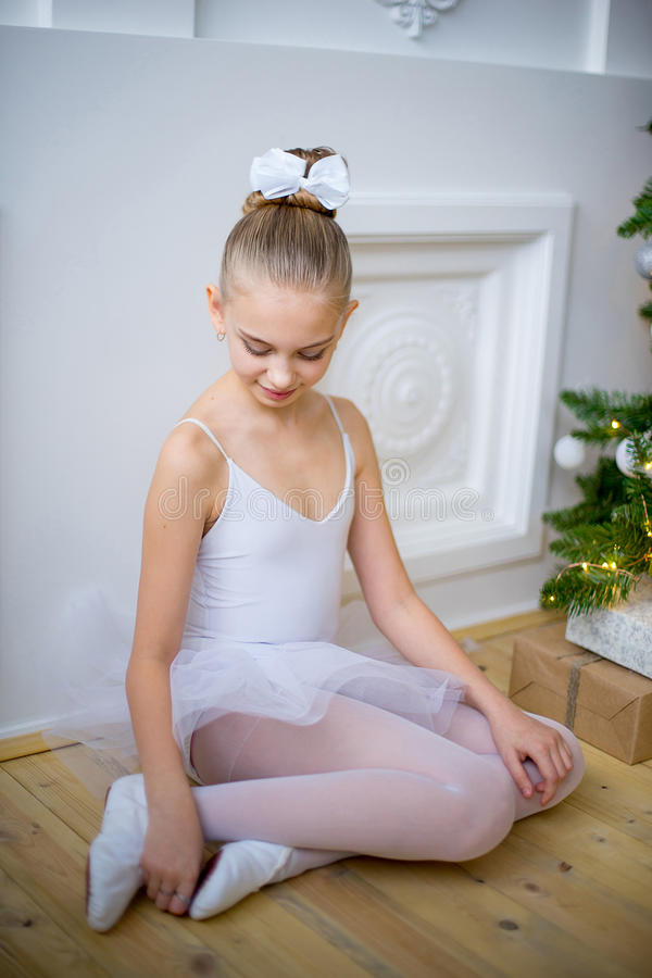 Free Young Ballet Dancer Sitting Near Christmas Tree Royalty Free Stock Photos - 83636498