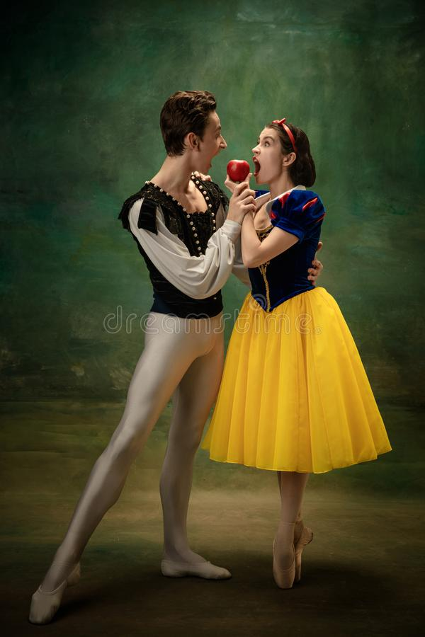 Young ballet dancers as a Snow White`s characters in forest modern tales. Young ballet dancers as a Snow White`s characters in forest. Flexible caucasian artists royalty free stock images