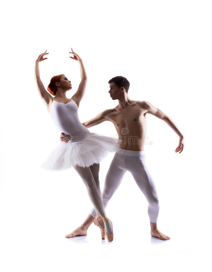 Young ballet dancers performing on white. Young couple of ballet dancers performing. Image is isolated on white stock photo