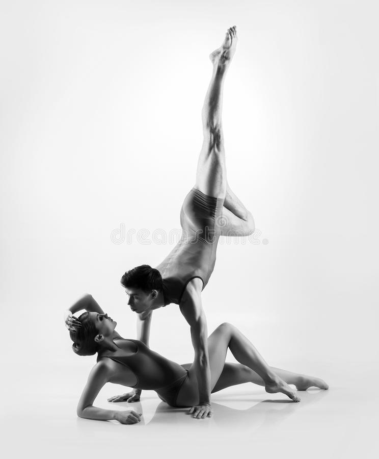 Young ballet dancers on a white background royalty free stock photo